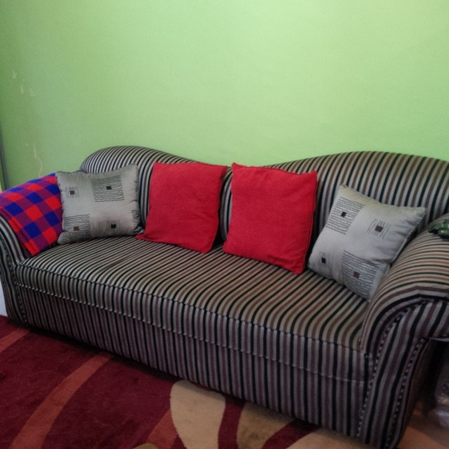 Simple, stylish couch (from Uchumi) and bright coloured pilows and masaai blanket as a throw.