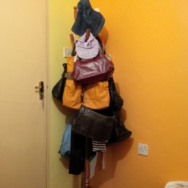 Coat hanger comes handy for those bags, hats